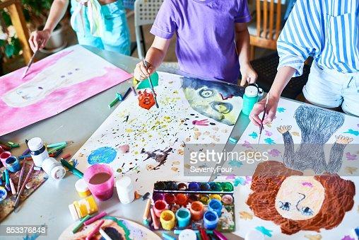 Hands of Children Painting in Art Class : Stock Photo