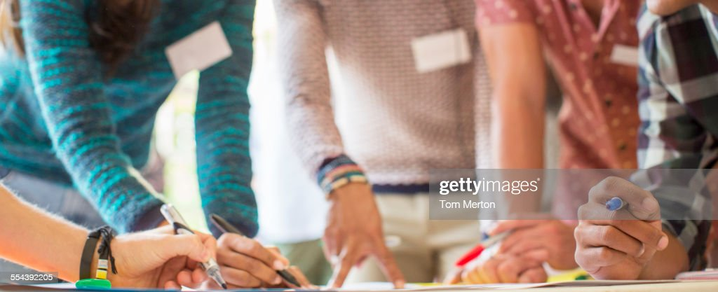 Hands of creative business people brainstorming in meeting