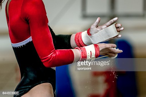 hands of girl in gymnast grips before performing on horizontal bar : Stock Photo