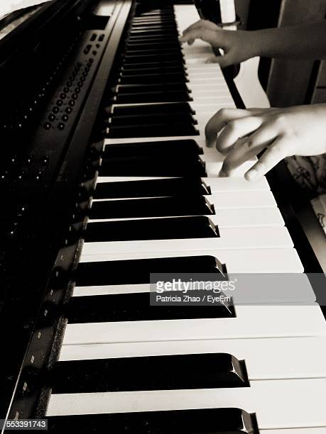 Hands Of Girl Playing Piano