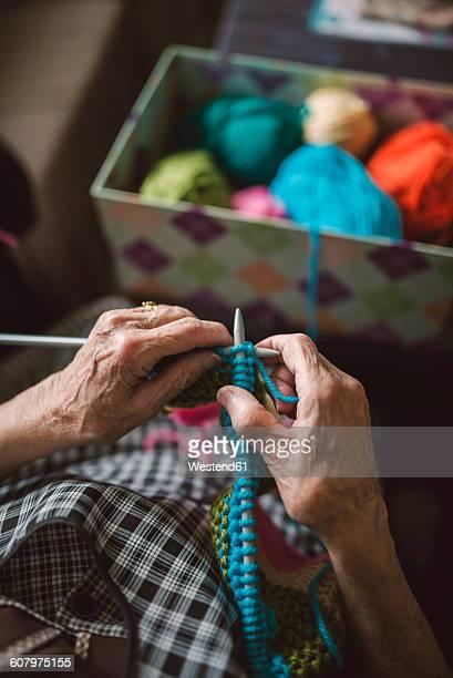 Hands of knitting senior woman, close-up