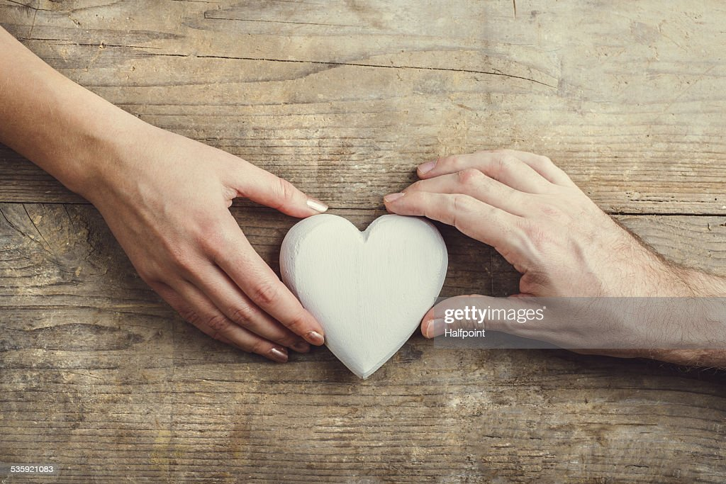 Hands of man and woman connected through a heart. : Stock Photo