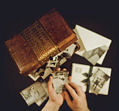 Hands of man holding old photographs