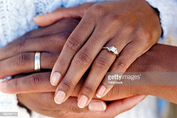 Hands of married couple wearing wedding rings