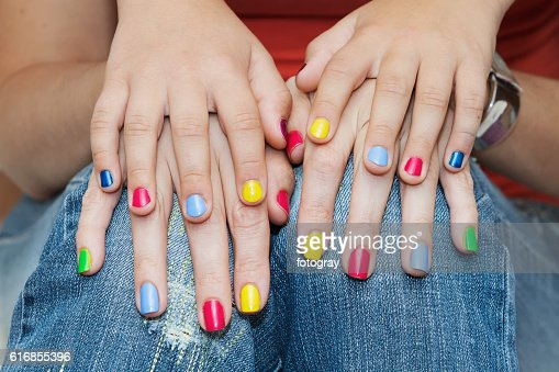 Hands of mother and daughter manicure. : Stock Photo