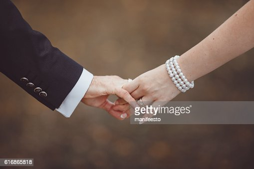 Hands of newlyweds. : Stock Photo