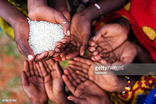 Hands of poor - asking for food, Africa