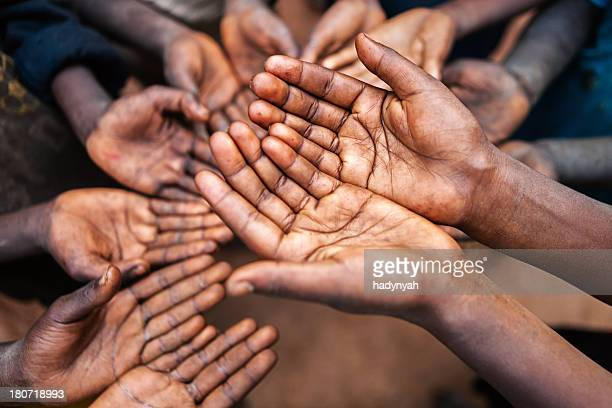 Hands of poor - asking for help, Africa