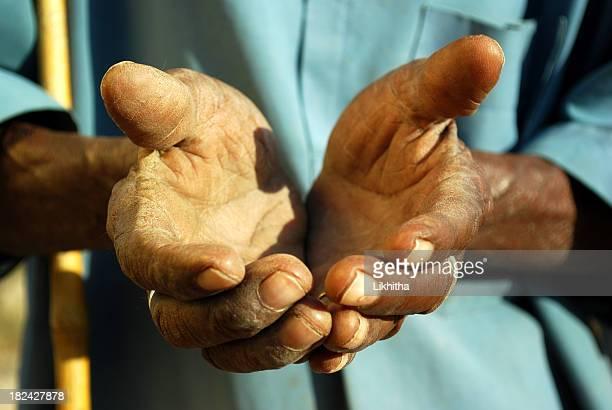 Hands of poor