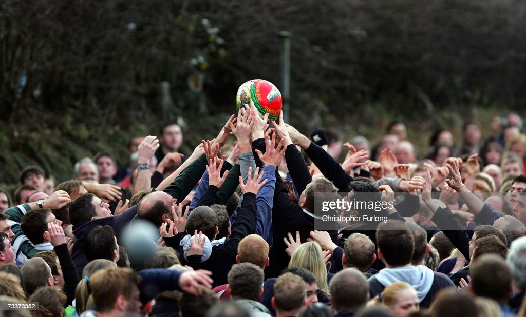 Hands of rival teams 'Up'ards' and 'Down'ards' battle for the ball in the annual Shrove Tuesday 'no rules' football match on February 20, 2007 in Ashbourne, England. The centuries-old tradition, played between teams from opposite ends of the Derbyshire town is played by hundreds of participants trying to get a ball into one of two goals that are positioned three miles apart. The ferocious game then lasts until 10 pm. If a goal is scored before 6 pm, then a new ball is 'turned up' again and a new game started. If the goal is after 6 pm then the game ends for that day and continues into Ash Wednesday.