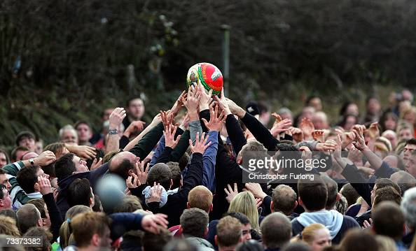 Hands of rival teams 'Up'ards' and 'Down'ards' battle for the ball in the annual Shrove Tuesday 'no rules' football match on February 20 2007 in...