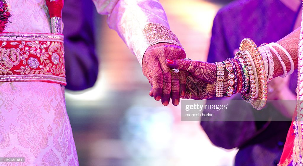 Hands of the bride & groom, wedding,India : Stock Photo
