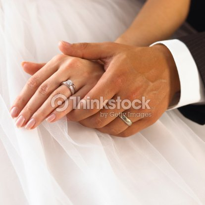 Hands of wedding couple : Stock Photo