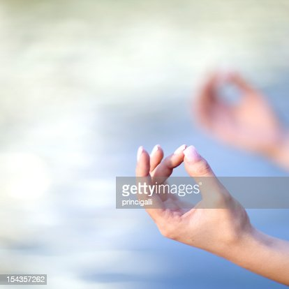 Hands of woman doing Yoga : Stock Photo
