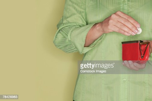 Hands of woman holding change and change purse