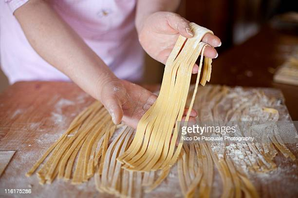 Hands of woman sorting some noodles