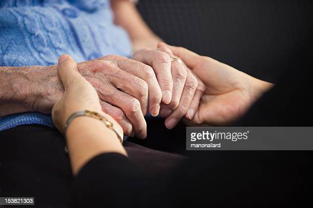Hands of young and old womans