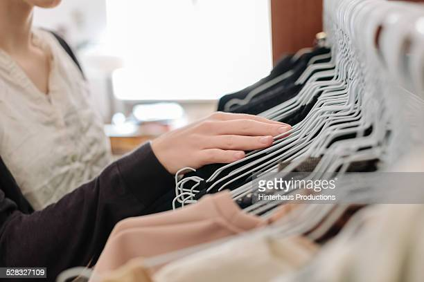 Hands Of Young Woman In A Wardrobe
