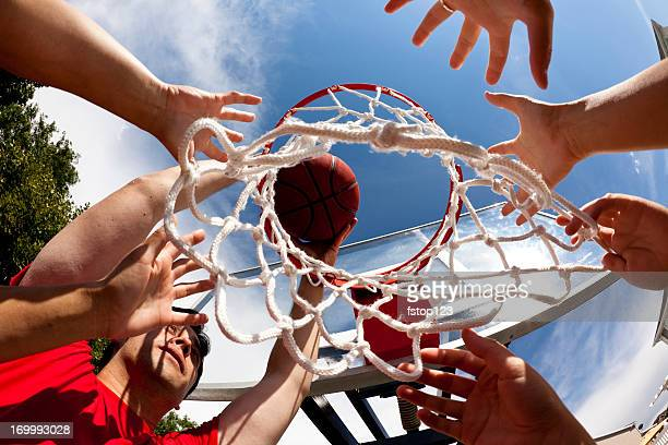 Hands on basketball goal. Sports. Playing. Directly below. Team.