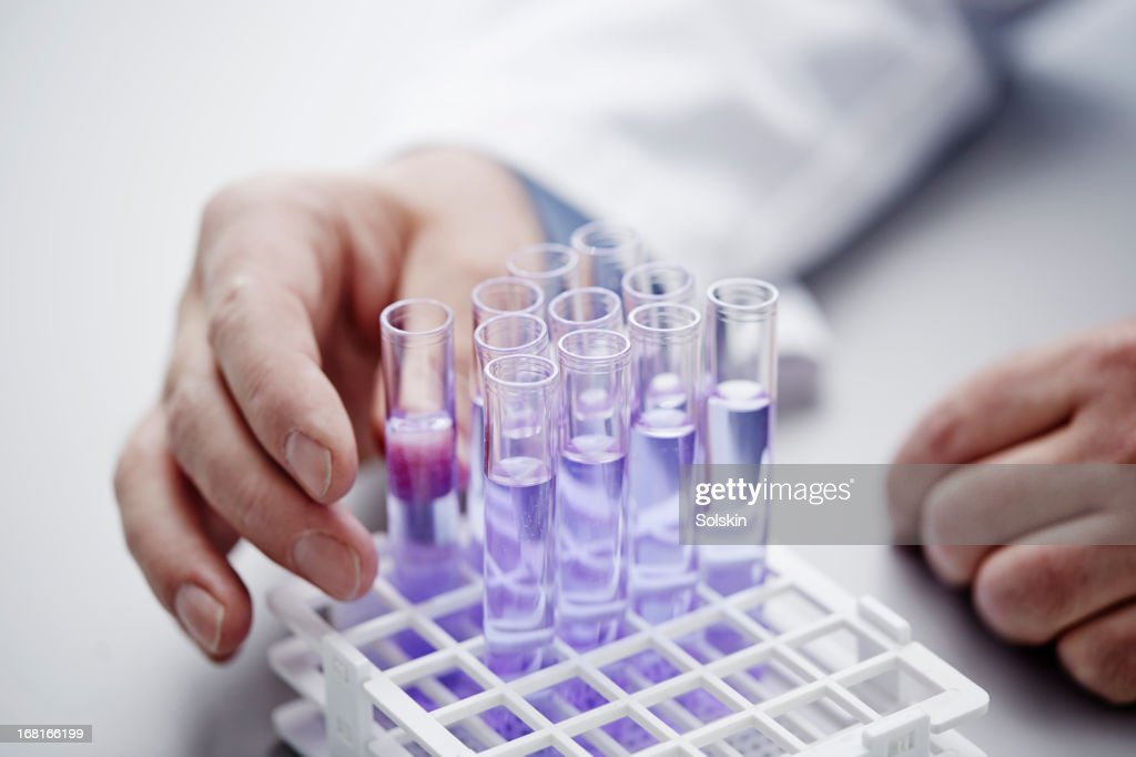 Hands on laboratory samples in glass tubes