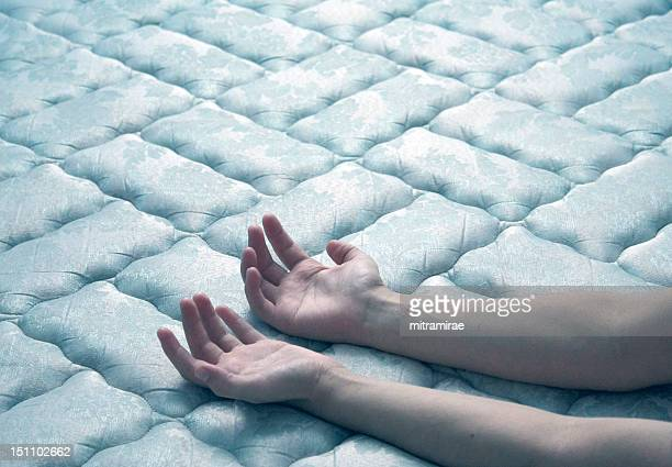 Hands on mattress