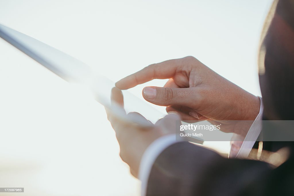 Hands on tablet pc. : Stock Photo