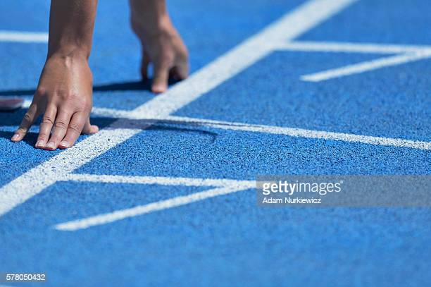 Hands on the track before a women's 100 metres qualification round during the IAAF World U20 Championships at the Zawisza Stadium on July 20 2016 in...