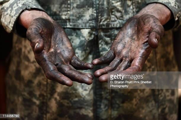 Hands open greasy dirty working man