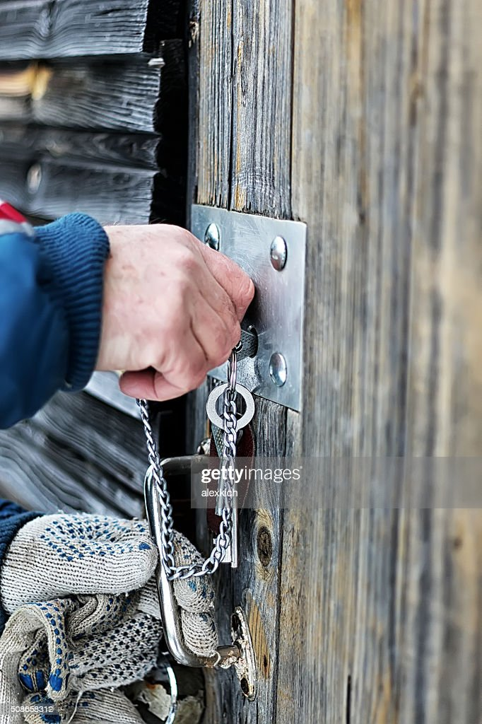 hands open padlock : Stock Photo