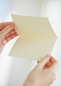 Hands opening a blank card