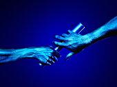Hands passing baton (blue tone)