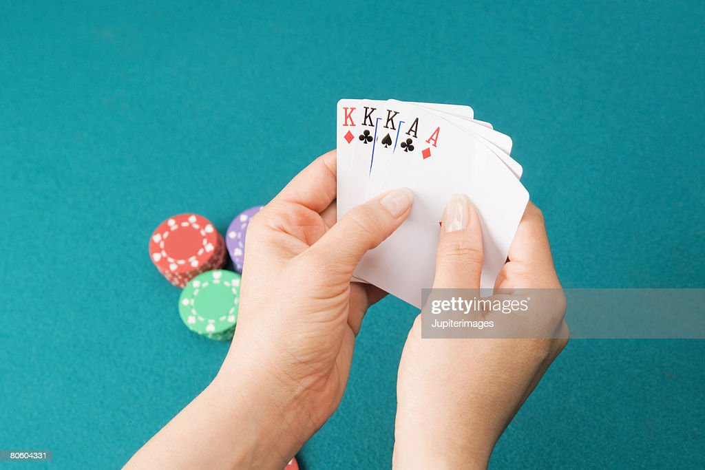 Hands playing cards with full house : Stock Photo