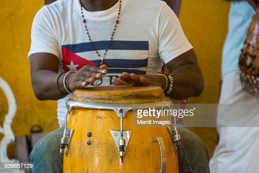 Hands playing Conga drum in Cuba