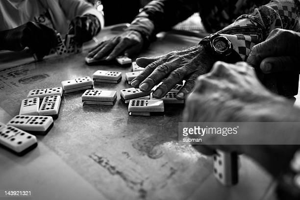 Hands playing dominos