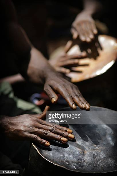 Hands playing primitive drums
