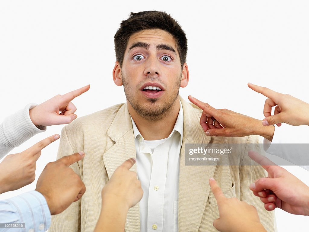 Hands pointing at man
