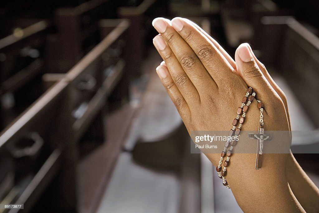 Hands Praying in Church With Rosary : Stock Photo