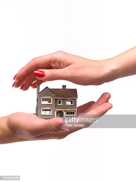Hands protecting house