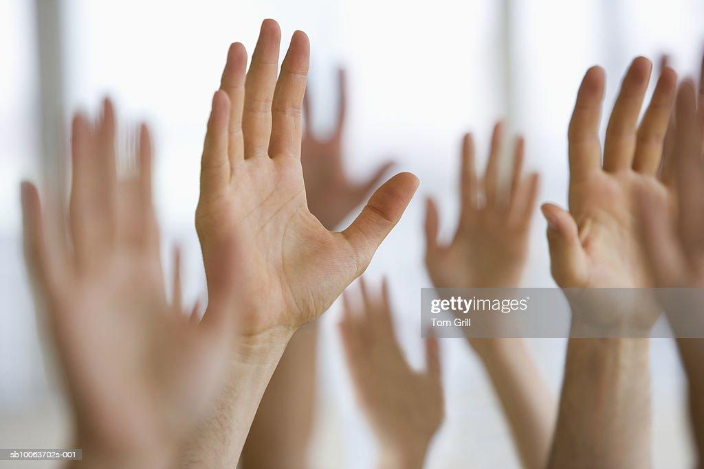 Hands raised in air (differential focus) : Stock Photo