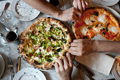Hands Reach for Naples-Style Pizza