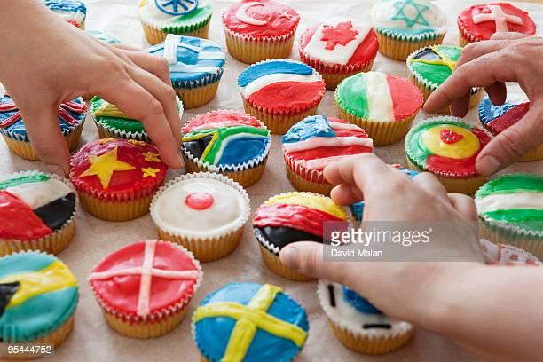 hands reaching for international kookies