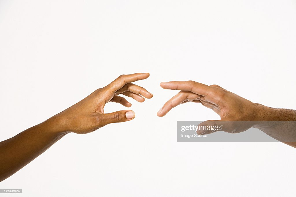 Hands reaching out : Stock Photo