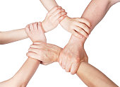 Five mixed arms clasped in unity