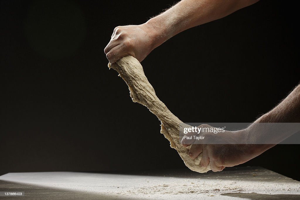 Hands Ripping Dough : Stock Photo
