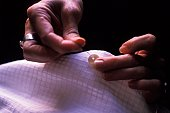 Hands Sewing on a Button