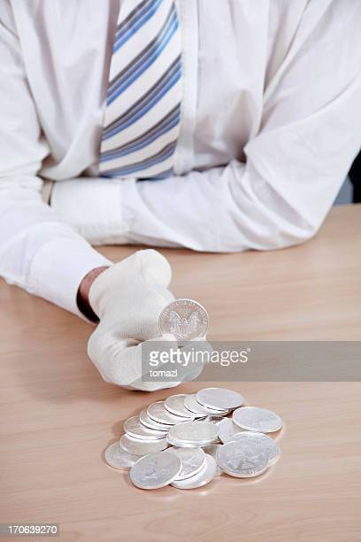 Hands showing sillver US coins