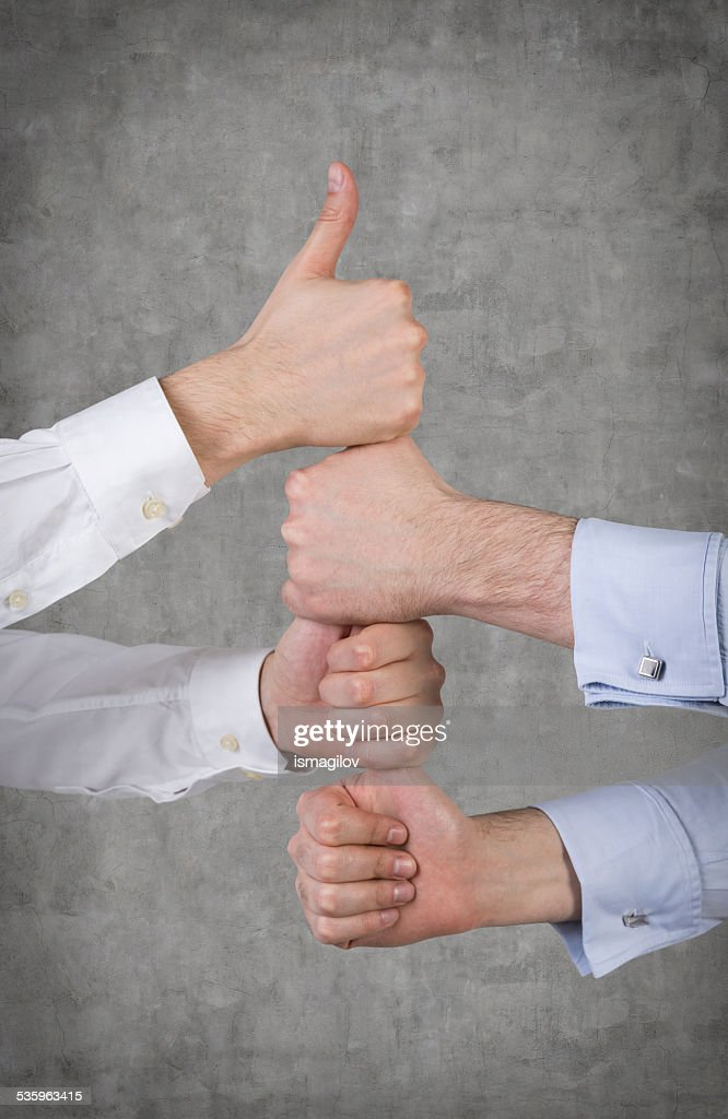 Hands showing thumb up : Stock Photo