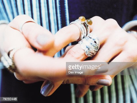 Hands, silver rings and painted nails, close up : Stock Photo