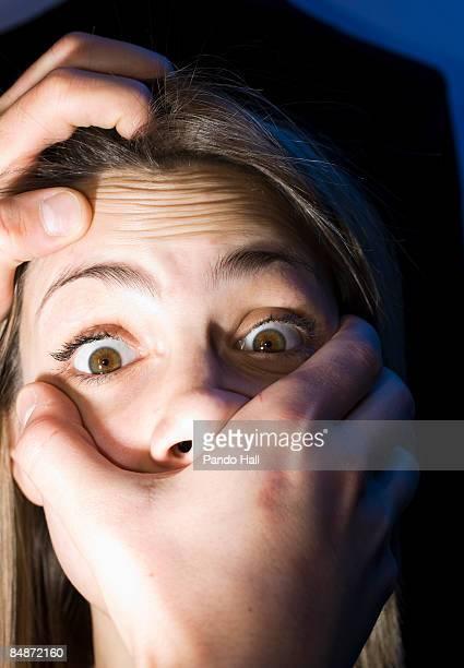 Hands strangling woman, close-up
