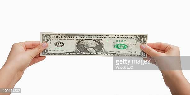 Hands stretching money